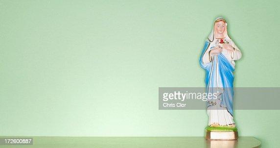 Religious figurine on counter top