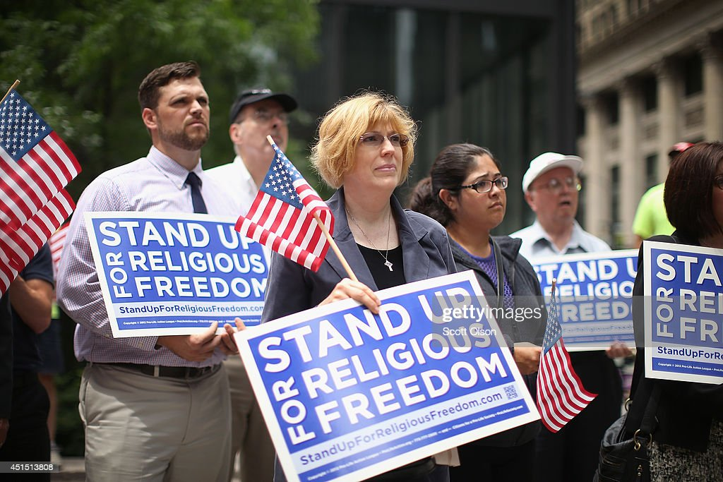 Religious freedom supporters hold a rally to praise the Supreme Court's decision in the Hobby Lobby contraception coverage requirement case on June...