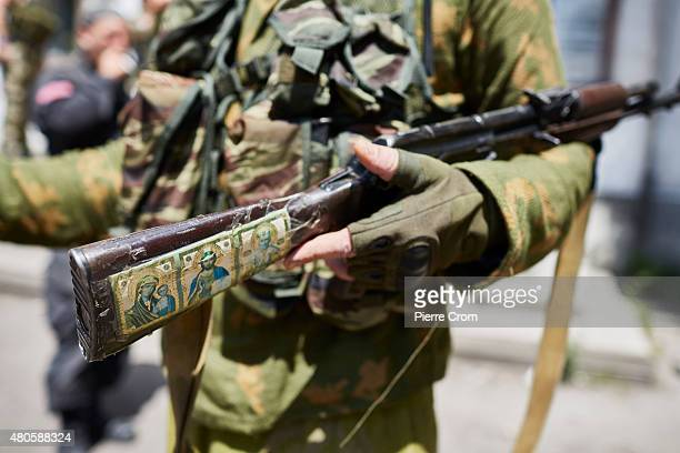 Religious images on a rifle of a proRussian fighter as ProRussian rebels fighters of the Prezrak batallion fighting on the side of selfproclaimed...