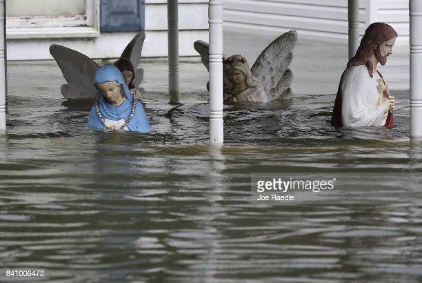 Religious items are seen in front of a home after the area was inundated with the flooding of Hurricane Harvey on August 30 2017 in Port Arthur Texas...