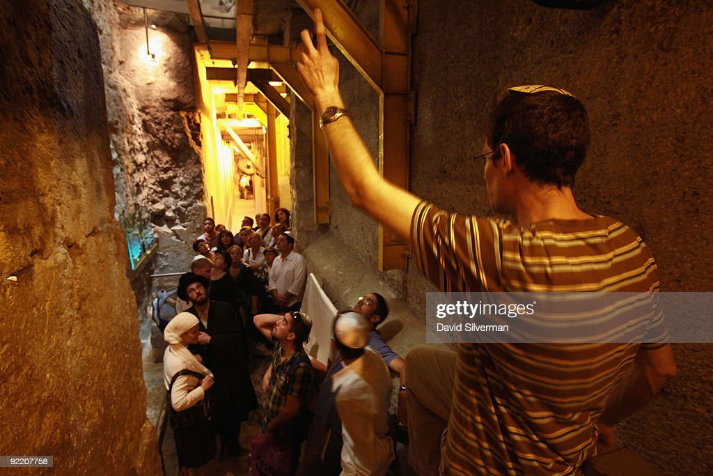 Religious Jewish visitors are guided through the Western Wall tunnels, on October 22, 2009 in Jerusalem's Old City. The Israeli Government Press Office organized a foreign press tour of the excavations which run alongside the outside of the Western Wall of the compound to categorically deny Palestinian claims that the Israeli Antiquities Authority is conducting digs underneath al-Aqsa mosque. The Temple Mount, which was the site of the 1st and 2nd Jewish Temples, is known to Muslims as el-Harem al-Sharif and is today the site of both the golden Dome of the Rock and al-Aqsa mosque, Islam's third holiest shrine.