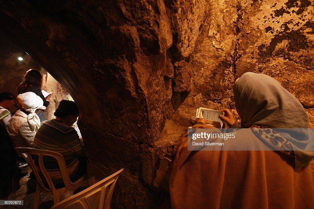 Religious Jewish women pray in a niche in the Western Wall tunnels, on October 22, 2009 in Jerusalem's Old City. The Israeli Government Press Office organized a foreign press tour of the excavations which run alongside the outside of the Western Wall of the compound to categorically deny claims that the Israeli Antiquities Authority is conducting digs underneath al-Aqsa mosque. The Temple Mount, which was the site of the 1st and 2nd Jewish Temples, is known to Muslims as el-Harem al-Sharif and is today the site of both the golden Dome of the Rock and al-Aqsa mosque, Islam's third holiest shrine.