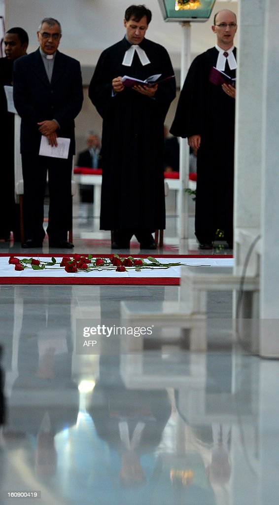 Religious leaders take part in an ecumenical service for the 238 victims of the Kiss nightclub fire in Santa Maria, southern Brazil, days ago, at Brasilia's Metropolitan Cathedral, in Brasilia on February 07, 2013. AFP PHOTO/Pedro LADEIRA