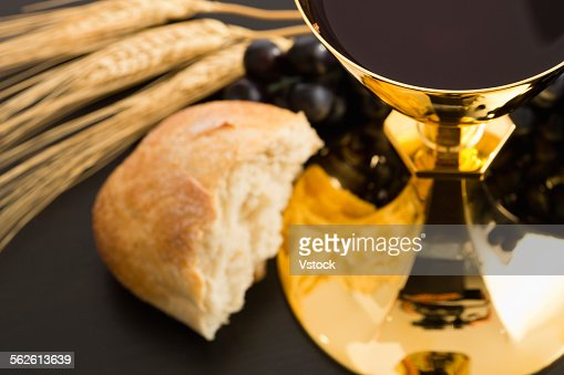 Religious offering, Christianity, gold chalice with wine, grapes, bread and crops