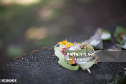 Religious Offering On Retaining Wall