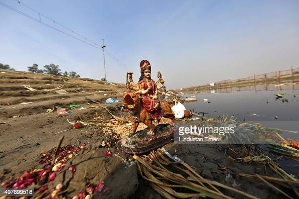 Religious offerings from devotees and leftover wooden frames earthen lamps and other pile up after the end of Chhath Puja festival at Kudsia Ghat on...