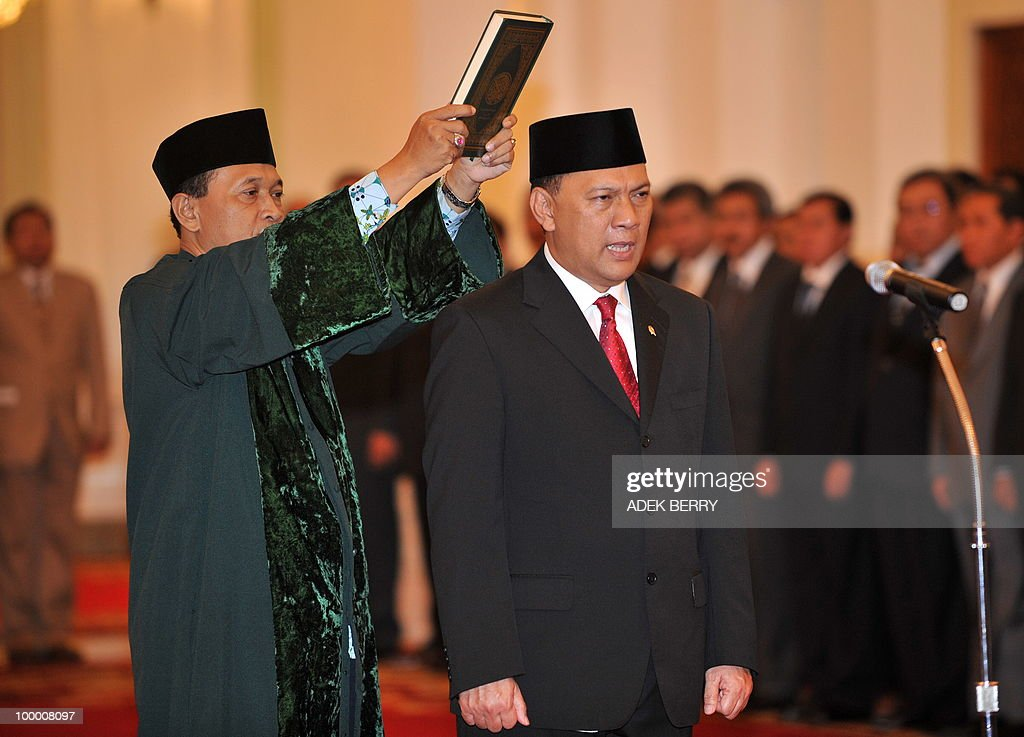 A religious officer holds a copy of the holy Koran next to incoming Finance Minister Agus Martowardojo (R) during the swearing in ceremony at the presidential palace in Jakarta on May 20, 2010. Indonesia's new finance minister faces an uphill struggle to restore investor's confidence after the shock resignation of his respected predecessor, analysts said. President Susilo Bambang Yudhoyono appointed PT Bank Mandiri chief Agus Martowardojo late on May 19, to replace independent economist Sri Mulyani Indrawati, who resigned on May 4 for a top job at the World Bank.