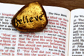 Bible with John 3:16 and a gold stone with Believe written on it. I have a vertical view of this image also.