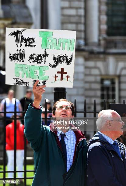 A religious protester holds a placard as Belfast Gay Pride takes place on August 5 2017 in Belfast Northern Ireland The province is the only part of...