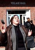 A religious protestor prays for the souls of the people to be wed during a Same sex wedding ceremony at the New Paltz Village Hall February 27 in New...