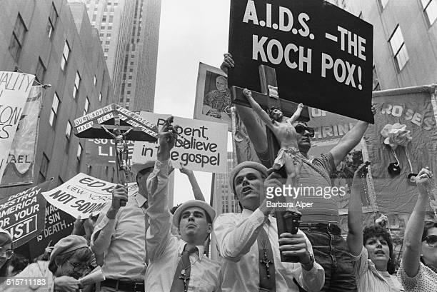 Religious protestors opposite St Patrick's Cathedral during a Gay Pride march in Manhattan New York City June 1985 The protestors are holding banners...