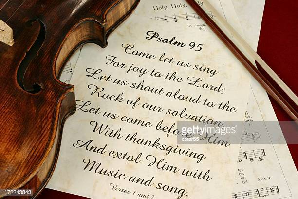 Religious: Psalm 95 scripture with hymns and old violin