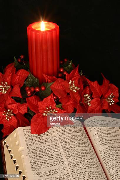 Religious: red Christmas Candle & open Bible with poinsettias
