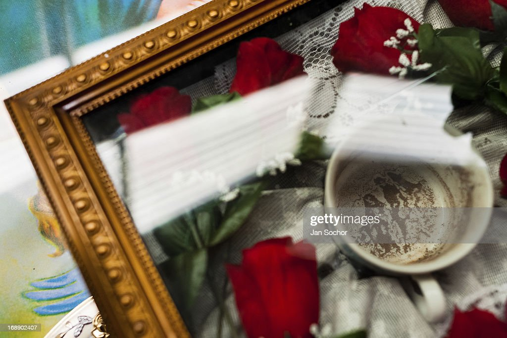 A religious relic holding a sign recorded in coffee ground seen at an altar of Hermes Cifuentes a Colombian spiritual healer in La Cumbre Colombia 27...