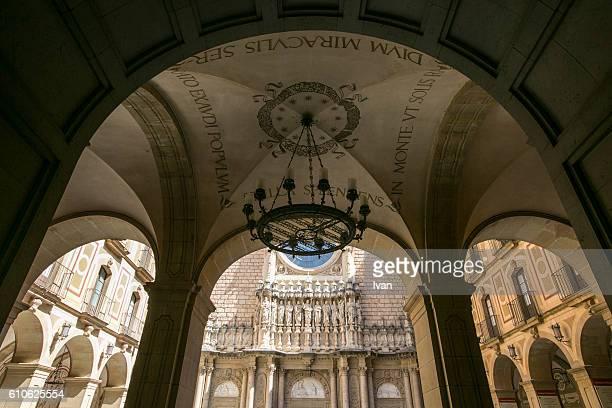 Religious sculptures on the faAade of the basilica at the Benedictine Abbey at Montserrat, Santa Maria de Montserrat, near Barcelona, Catalonia, Spain