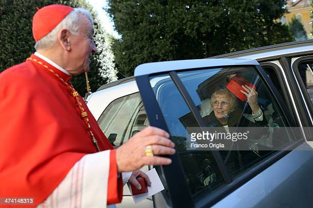 A religious sister plays with the biretta of new Cardinal Archbishop of Westminster Vincent Nichols as they leave St Peter's Basilica after attending...