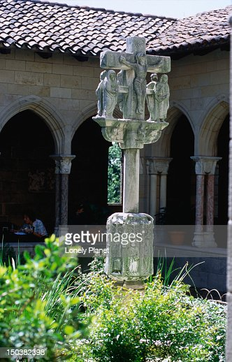 A religious statue of carved stone in the gardens of The Cloisters, a museum in the grounds of the Fort Tryon Park, housing the Metropolitan Museum of Art's collection of medieval art.