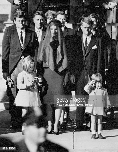 Relinquishing his mother's hand John F Kennedy Jr salutes his father's flagdraped casket in funeral procession for President John F Kennedy in...