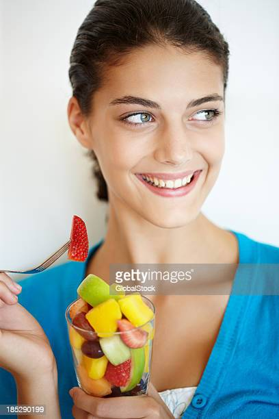 Relishing a crisp and juicy fruit salad in the morning