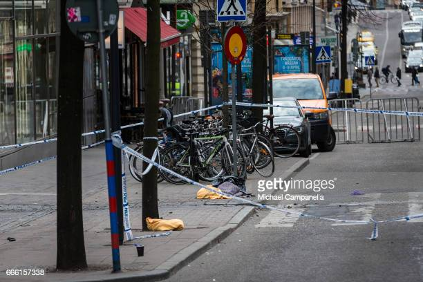 Remains covered with towels at the scene of the terrorist truck attack in downtown Stockholm on April 8 2017 in Stockholm Sweden