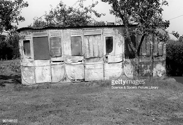 Remains of a broad gauge carriage 1967 A Great Western Railway broad gauge carriage slowly disintegrating in a Gloucestershire garden Photograph by...