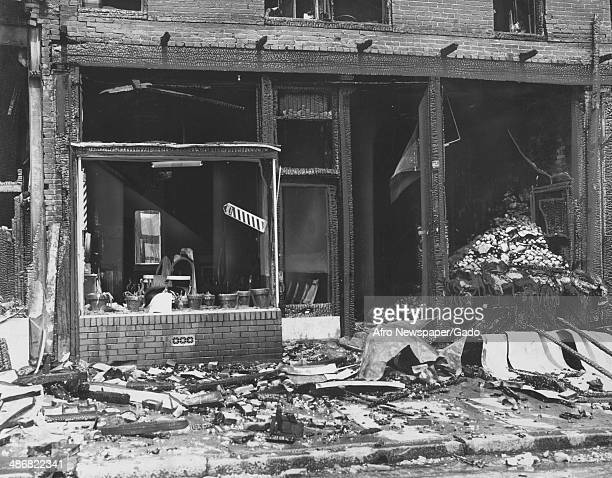 Remains of a burned dry goods storefront and barber shop with scorched wood broken windows and debris following a fire at the Lafayette Market...