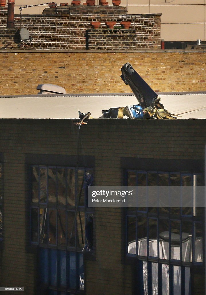 Remains of a helicopter can be seen in the roof of a building on January 17, 2013 in London, England. Police cordons have remained in place as investigations continue into the cause of yesterday's helicopter crash in which two people died.