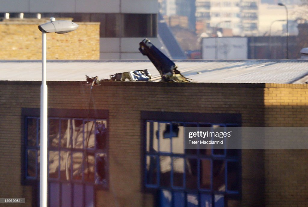 Remains of a helicopter sit on the roof of a building on January 17, 2013 in London, England. Police cordons have remained in place as investigations continue into the cause of yesterday's helicopter crash in which two people died.