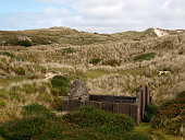 Remains of a National Explosives Works building in the sand dunes at Upton Towans Gwithian Cornwall UK