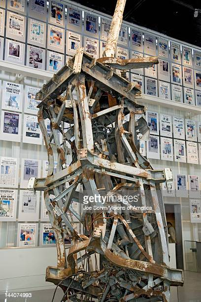 Remains of antenna from the top of World Trade Centers with 9/11/01 headlines behind it on display at the Newseum Museum Washington DC