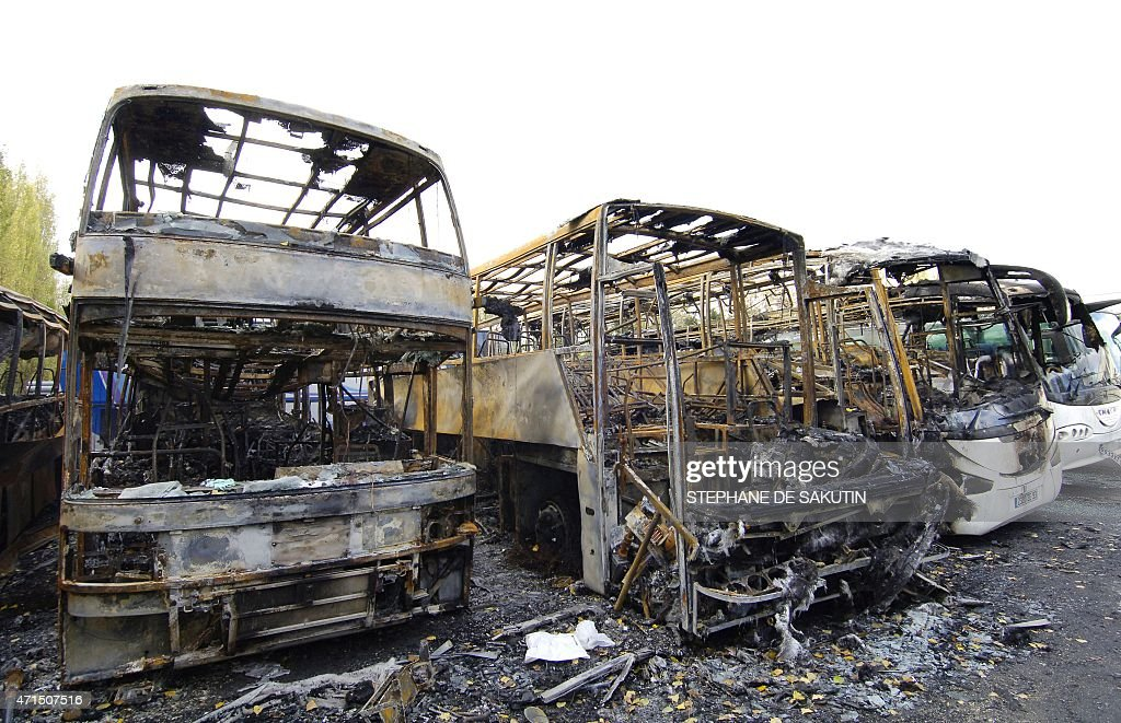 Remains of burned buses set ablaze overnight by rioters are seen 03 November 2005 in the northern Paris suburb of AulnaysousBois Authorities in...