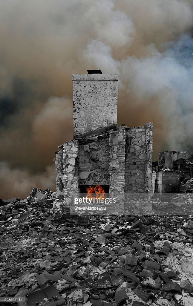 remains of house after fire : Stock Photo
