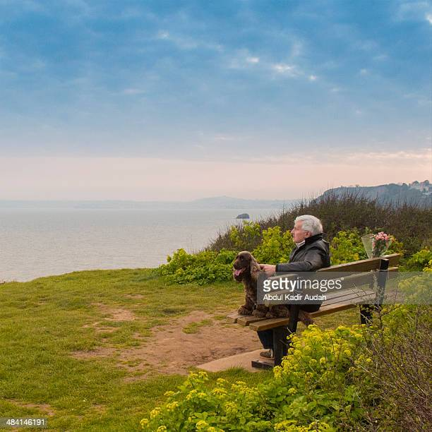 I remember you an older man accompanied by his dog contemplating sitting on a bench on cliff facing the sea