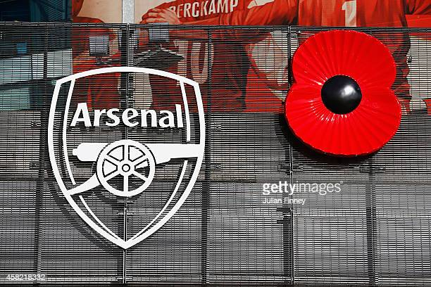 A rememberance poppy is displayed next to the Arsenal logo ahead of the Barclays Premier League match between Arsenal and Burnley at Emirates Stadium...