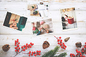 Photo album in remembrance and nostalgia in Christmas (winter season) on wood table. photo of retro camera - vintage and retro style, topview