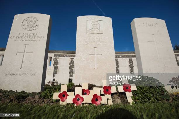 Remembrance crosses and poppies sit in front of a headstones in Tyne Cot Cemetery on April 6 2017 in Zonnebeke Belgium July 31st marks the centenary...