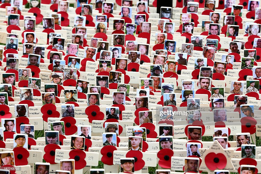 Remembrance crosses outside Westminster Abbey after the official opening of the Royal British Legion's Field of Remembrance on November 7, 2013 in London, England. Hundreds of small crosses bearing a poppy have been planted in the Field of Remembrance to pay tribute to British servicemen and women who have lost their lives in conflict.