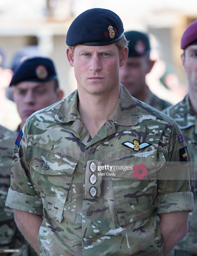A remembrance poppy adorns the uniform of <a gi-track='captionPersonalityLinkClicked' href=/galleries/search?phrase=Prince+Harry&family=editorial&specificpeople=178173 ng-click='$event.stopPropagation()'>Prince Harry</a> as he joins British troops and service personal remaining in Afghanistan and also International Security Assistance Force (ISAF) personnel and civilians as they gather for a Remembrance Sunday service at Kandahar Airfield November 9, 2014 in Kandahar, Afghanistan. As the UK combat mission in Afghanistan draws to an end in 2014 this year, which also marks the 100th anniversary of the start of World War One, 70 years since the D-Day landings will be the last time British service personal will gather in any great numbers in the south of the country.