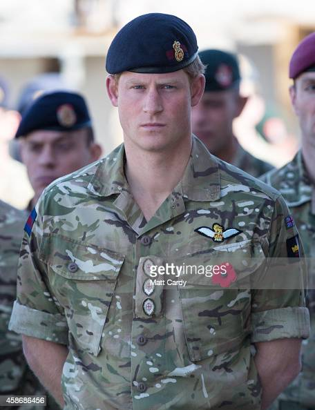 A remembrance poppy adorns the uniform of Prince Harry as he joins British troops and service personal remaining in Afghanistan and also...