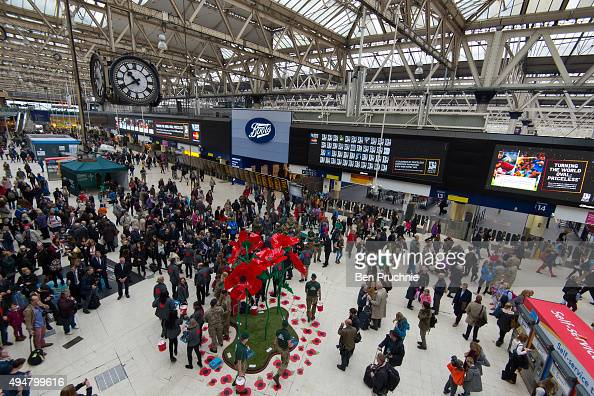 A remembrance sculpture made of 3 meter high poppies is unveiled at Waterloo Station during the launch of the British Royal Legion's London Poppy Day...