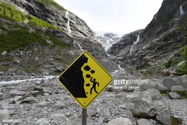 Remenance of glaciers in Norway Fjord highlands displaying waterfalls and melting ice rives on February 8th 2017 in Norway