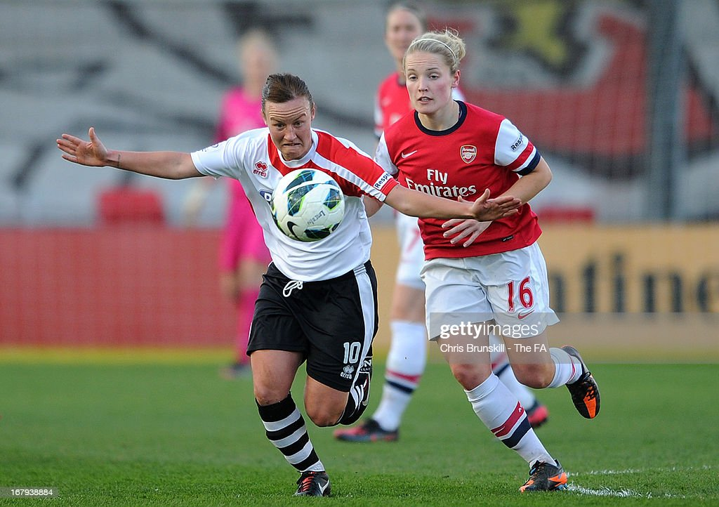 Remi Allen (L) of Lincoln Ladies in action with Kim Little of Arsenal Ladies during the The FA WSL Continental Cup match between Lincoln Ladies and Arsenal Ladies at Sincil Bank Stadium on May 2, 2013 in Lincoln, England.