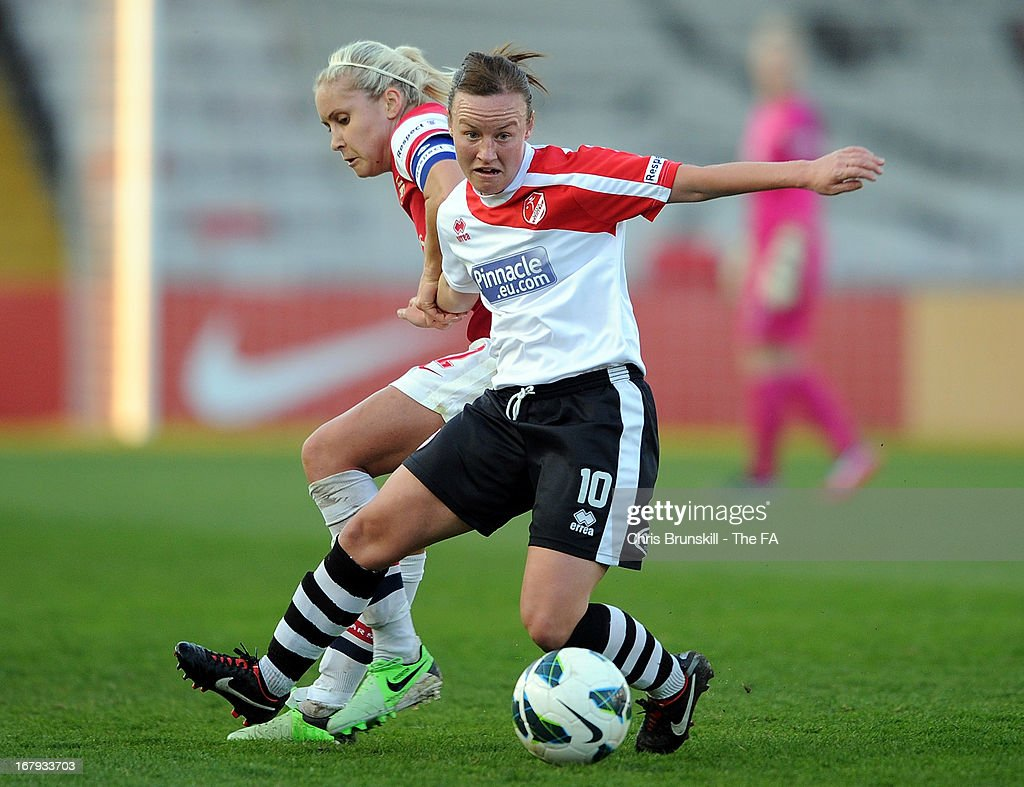 Remi Allen (R) of Lincoln Ladies in action with Steph Houghton of Arsenal Ladies during the The FA WSL Continental Cup match between Lincoln Ladies and Arsenal Ladies at Sincil Bank Stadium on May 2, 2013 in Lincoln, England.