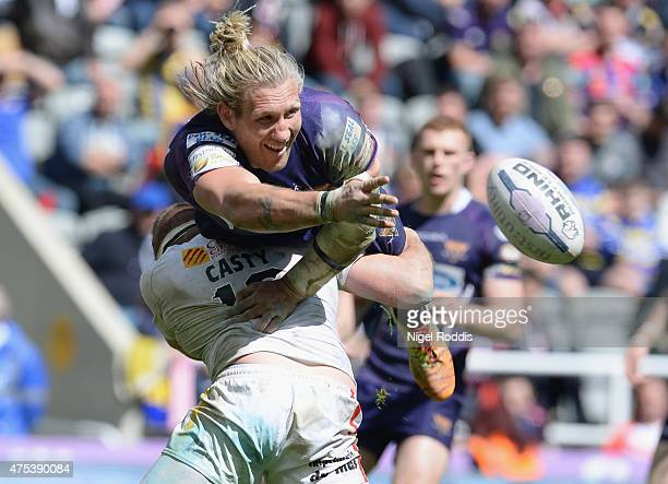 Remi Casty of Catalans Dragons tackles Eorl Crabtree of Huddersfield Giants during the Super League match between Catalans Dragons and Huddersfield...
