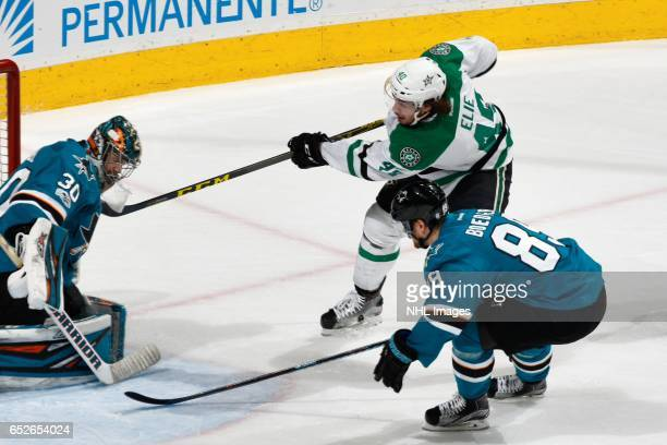 Remi Elie of the Dallas Stars gets one by Aaron Dell of the San Jose Sharks to score a goal in the first period at SAP Center at San Jose on March 12...