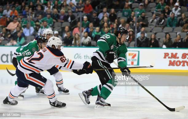 Remi Elie of the Dallas Stars is hooked by Eric Gryba of the Edmonton Oilers in the first period at American Airlines Center on November 18 2017 in...