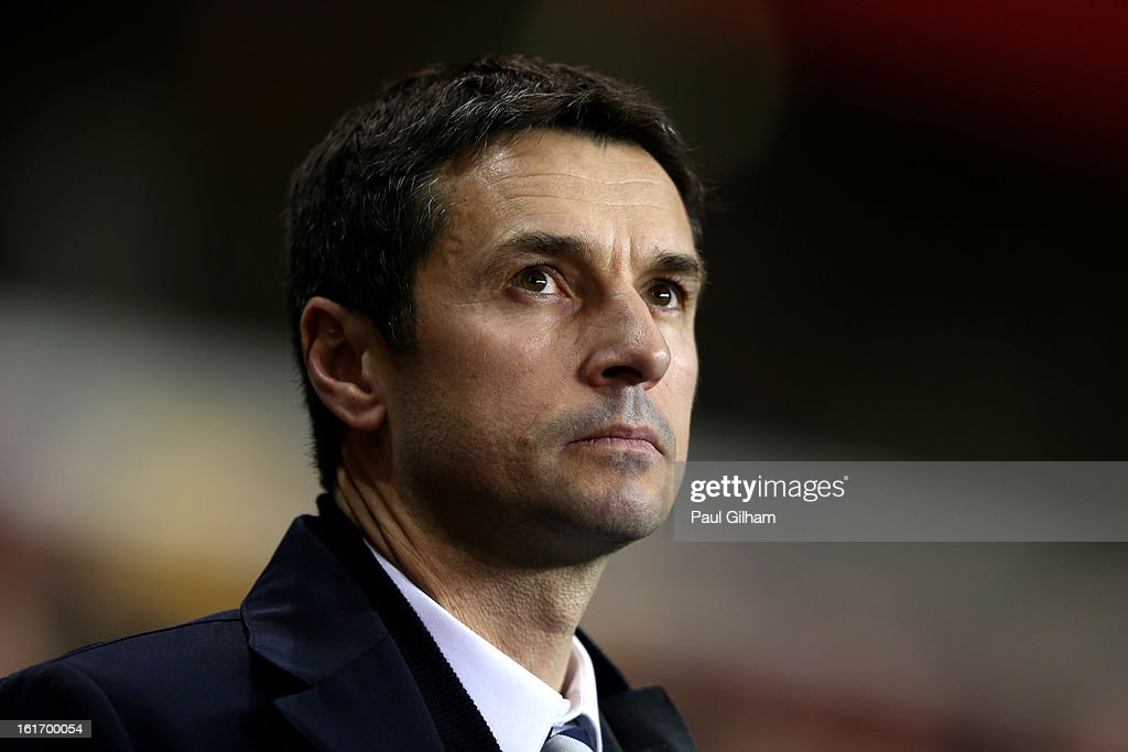 Remi Garde the Head Coach of Olympique Lyonnais looks on during the UEFA Europa League round of 32 first leg match between Tottenham Hotspur and...