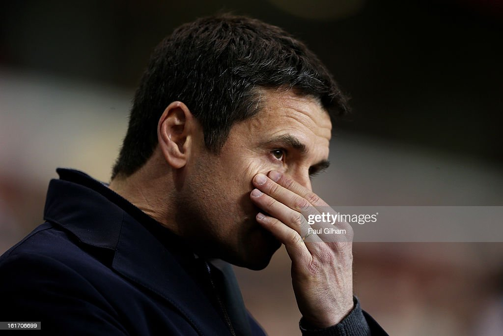 Remi Garde the Head Coach of Olympique Lyonnais reacts during the UEFA Europa League round of 32 first leg match between Tottenham Hotspur and...