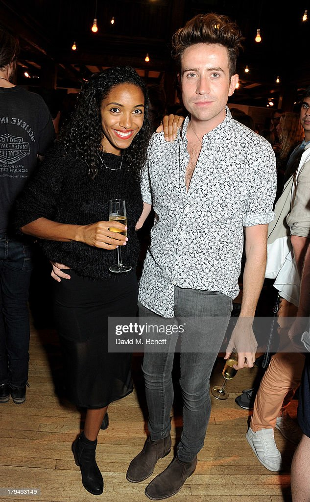 Remi Nicole (L) and Nick Grimshaw attend the launch of Alexa Chung's first book 'It' at Liberty on September 4, 2013 in London, England.