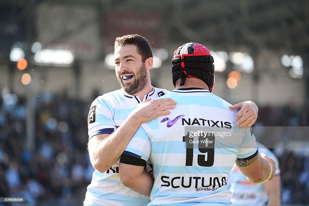 Remi Tales of Racing 92 and Chris Masoe of Racing 92 celebrate winning during the French Top 14 rugby union match between Racing 92 v Clermont at Stade Yves Du Manoir on May 1, 2016 in Colombes, France.